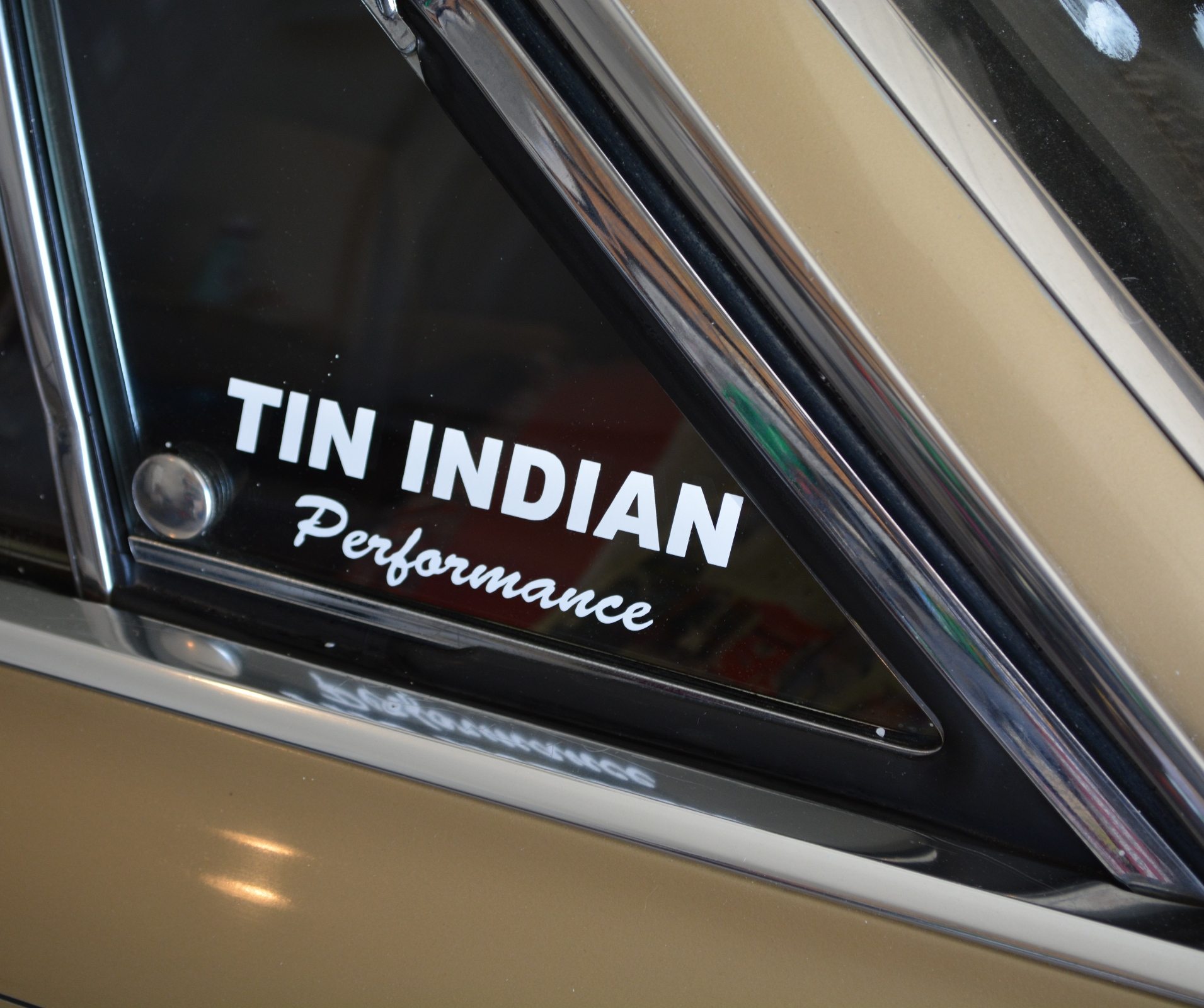 Tin Indian Performance Pontiac contingency sticker on car